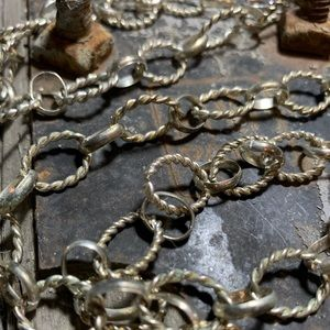 Silver twisted and flat loop chain necklace.